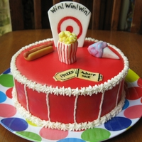 Carnival Cake Red and white striped cake covered in Fondant. Popcorn, hot dog, cotton candy, tickets, and target are all gum paste.