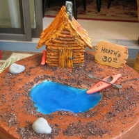 Cabin-On-The-Pond Cake Chocolate Cake with buttercream frosting. Pond is Jello; Cabin is made from pretzels and royal icing with hand-painted details. Kayak,...