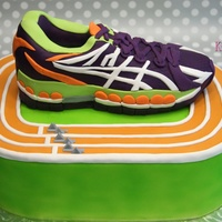 "Track Star Track is 11"" x 15"" sheet and running shoe is carved out of 9"" x 11"" sheet. All fondant. TFL!"