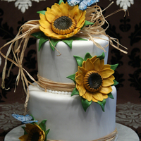 "Harvest Wedding 8"" and 6"" rounds covered in fondant. Gumpaste sunflowers and leaves. Non-edible butterflies and raffia. :-)"