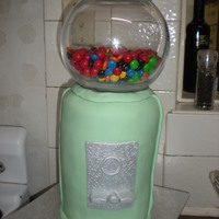 Melissa's Gumball Machine Gumball machine for my sister's birthday party. 8 layers of cake, 6 inch rounds. The glass bowl is full of Jaffas and M&Ms. It was...