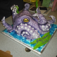 Octopus Its half sheer cake carved in the shape of the octopus covered in buttercream. the tips of the tentacle are made out of fondant and air...
