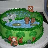 Jungle Out There   I made this cake for a little boys birthday. It is covered in buttercream and all the animals are fondant.