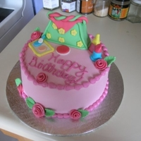 Girly Girl Cake   I made this 6 inch round cake for a friend that is such a girly girl!! It is covered in butter cream and all the decorations are fondant.