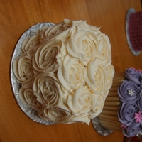 Rosette Cake   This is a 6 inch round cake covered in buttercream rosettes. It is so simple to do but everyone loved how pretty it looks.