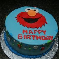 Elmo  This is my first time being asked to make an Elmo cake. This is an 8 inch round covered in butter cream and all the decorations are fondant...