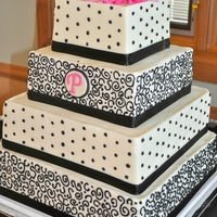 Black, White, And Pink Wedding Cake 6,9,12, and 14 squares with fondant monogram.