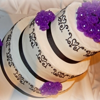 Wedding Cake With Damask Design 6, 9, and 12 rounds with damask design and ribbon.