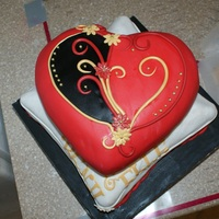 Heart And Cushion engagement cake that turned out to be a secret wedding.