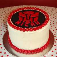 Micah's Transformer Cake Chocolate cake with fresh strawberries and cream cheese frosting. The Transformer cake topper is made of fondant. The red decorations are...