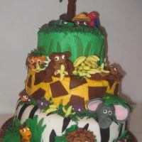 3-Tiered Jungle Cake My 6-year-old wanted a jungle cake. Top layer is yellow cake with buttercream frosting and fondant accents. Middle layer is chocolate with...