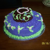 1318970784.jpg Tinkerbell cake for my 5 year old daughter....placed a tinkerbell candle on the top (not shown in picture)