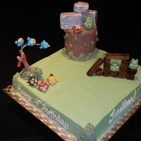 Angry Birds  This is a cake I did for my nephew who turned 4. All birds and pigs are handmade out of gum paste, sling shot is also gum paste, boards,...