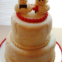 Winter Wonderland Wedding Snow Bride & Snow Groom on sparkling drifts of snow with sugar snowflakes.