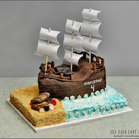 Pirate Ship First ship totally ripped apart, so much work went into this cake. What a great learning experience it was!