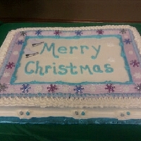 Merry Christmas sheet cake with snowflakes and a pair of ice skates