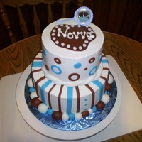 Novva   Baby boy Novva ~stacked round with buttercreme/fondant accents.