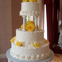 Yellow Rose   Round Tiered Wedding Cake. Cornelli lace with fresh yellow roses