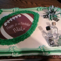 "21St Birthday   edible image football, mini liquor bottles, ""21""picks & ribbon"