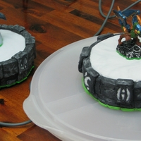 Skalander Portal Skylander portal cake side by side with a real portal. The character on top of the cake is a toy.