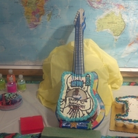 Guitar   I made the cake stand and and cake to look like one piece for my grandsons' birthday. It was the highlight of his day.