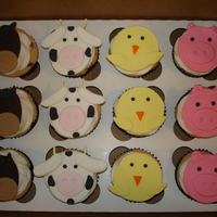 Farm Animal Cupcakes   Strawberry cupcakes iced in buttercream, with fondant toppers. Made to go along with my farm animal cake. Thanks for looking!