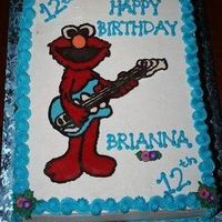Brianna's Elmo Cake This is my second chocolate transfer. Cake is 11X15. WASC with lemon curd filling and Buttercream Dream icing.