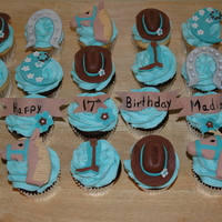 Cowgirl Chic! Cowgirl themed cupcakes. I was trying to do a more mature take on a cowgirl. Hat, boots, horseshoe, banner, horse head and bandana swirl...