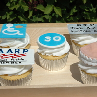 Over The Hill Cupcakes   Over the Hill cupcakes - dentures, gravestone, AARP card and Handicap sign all fondant details.