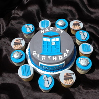 Dr. Who Cupcakes All accents and discs are fondant. 8 inch round cake frosted in gray butter cream.