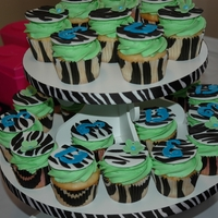 "Zebra Print Cupcakes Zebra print cupcakes with fondant flowers and the #13 and letter ""E"". The letter and number were cut out with my Cake Cricut. It..."