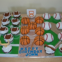Sports Theme Cupcakes   This cake was for a little boy who loves basketball, baseball and football. All accents are done in fondant.