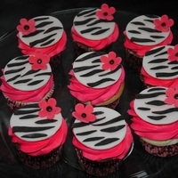 Zebra Stripes And Pink Flowers Black and white zebra stripes with a pink flower accent. Details made out of fondant.