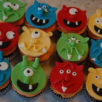 Monster Cupcakes Fondant monster faces for a birthday order.