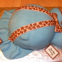 Belly Cake 1st attemp at a pg belly cake for a friend. Baby shower was a safari theme so she requested to giraffe print on the ribbon. Just wish I had...