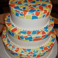 Barcelona Tiled Wedding Cake Based off of a mosaic tiled bench by Gaudi in Barcelona, this wedding cake had tiles colored and individually cut to fit together. Base...