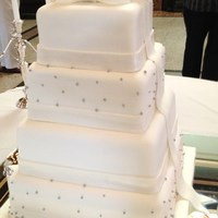 "Elegant Ribbon And Brooch Fondant covered squares, 8,10,12,14"", with fondant ribbons, silver pearl luster dusted pearls and double gum paste bow on top with..."
