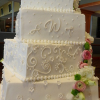 Trailing Flowers  Iced in B/C, this 5 tier Square Offset cake had fondant and gum paste accents. Each tier was decorated with a different design and the...