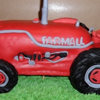 Farmall Tractor Cake   Carved tractor cake covered in fondant, made for a 60th birthday boy!