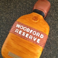 Whiskey Bottle Cake Made to resemble a Woodford Reserve Whiskey, this cake was carved and covered in fondant. Stain washed with mixed colors for an amber...