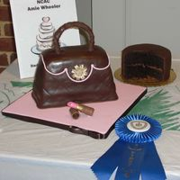 2009 Chocolate Festival - Best In Taste Dark chocolate cake - milk chocolate filling - thick dark chocolate crumb coat - then sating ice dark chocolate fondant - It was really fun...