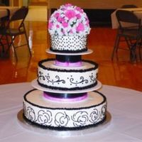 Black And White Wedding This is my very first wedding cake. The bride just loved it. The bottom tier was decorated with the pattern of her dress. I really enjoyed...