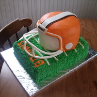 Browns Helmet Chocolate cake, buttercream icing.... chocolate clay stripe, fondant mask.