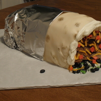 Burrito Cake!  Design is not my idea... hubby found a cool pic of a burrito cake online and sent it to me. So thanks to whoever came up with this...