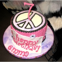 Peace Sign Birthday Cake Buttercream with a fondant peace sign, name plaque, tappits letters in gumpaste.