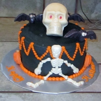 Halloween Cake For My Nephew french vanilla cake w/ rasp filling & buttercream icing. Skull, bats etc molded chocolate