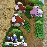 Smurfs Smurfs cake for my daughter birthday.Smurfs house are cookies. Bushes are edible image on fondant. Background image is also edible paper.