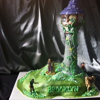 Tangled Tower Cake Figures Are Toys Tower Is Made From Rice Krispies Tangled Tower Cake, figures are toys, tower is made from rice krispies.