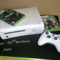 Xbox Cake white xbox cake with edible games and rice krispie controller