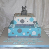 Teddy Bear Christening Cake 2 tier christening cake with edible bear and booties